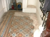 murray-victorian-tiling-contract-glasgow-showing-area-of-lifted-tiles-stairside